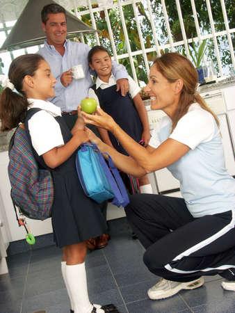 Hispanic family getting their kids ready for school