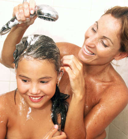 rejuvenated: Mother and daughter showering in the bathroom Stock Photo