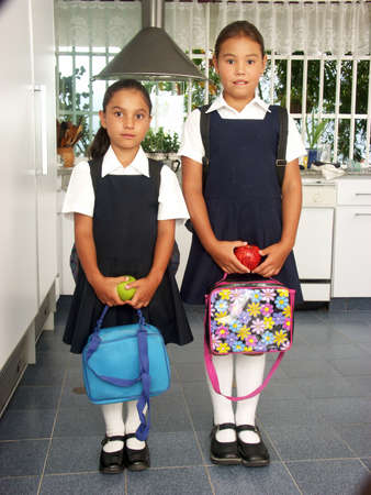 Little hispanic girls ready to go to school photo