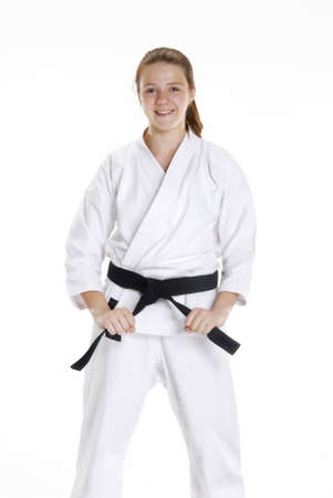 Young caucasian girl in martial arts uniform  Banque d'images