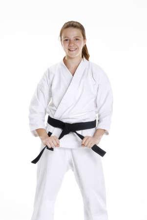 Young caucasian girl in martial arts uniform  Stock Photo