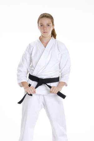 Young caucasian girl in  martial arts uniform