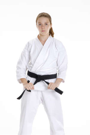 Young caucasian girl in  martial arts uniform photo