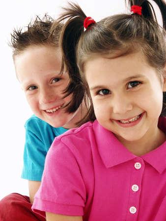 Two happy children on white background Stock Photo