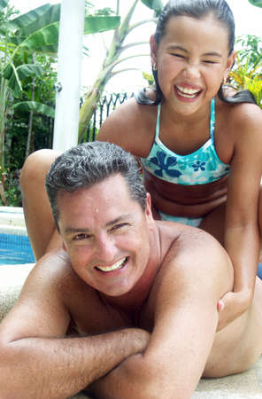 Hispanic father and daughter at the swimming pool Stock Photo - 22480436