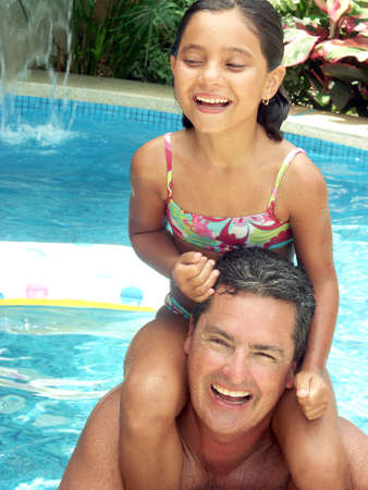 Hispanic father and daughter at the swimming pool Stock Photo - 22480443