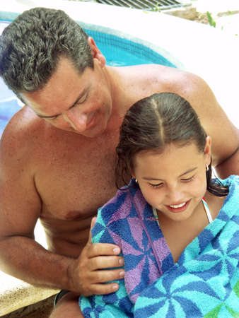 Hispanic father and daughter at the swimming pool Stock Photo - 22480454