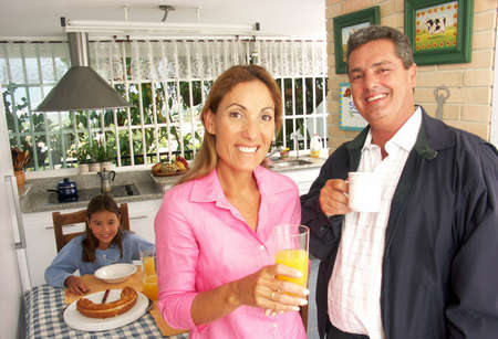 Hispanic couple in a kitchen with their child