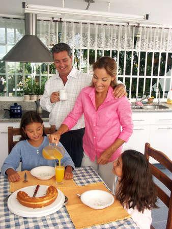 Hispanic family having breakfast in a kitchen