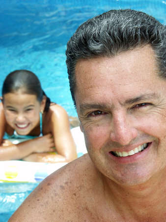 Hispanic father and daughter enjoying a swimming pool Stock Photo - 22525805