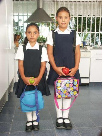Little hispanic girls ready to go to school photo