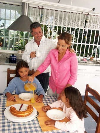 Hispanic family having breakfast in a kitchen photo