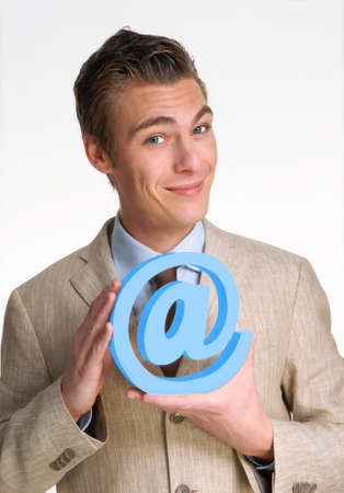 Businessman holding an at sign Stock Photo - 22520935