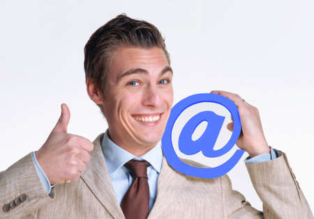 Businessman holding an at sign Stock Photo - 22520938