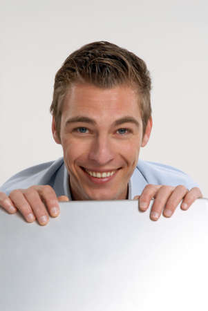 Young businessman using a laptop on white background Stock Photo - 22521021