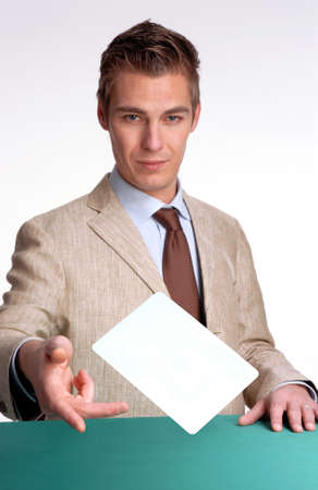 Young man throwing a card
