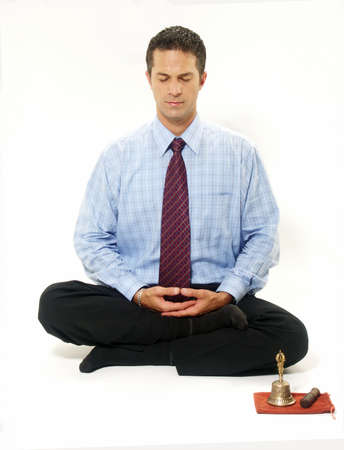 Businessman in yoga position on white background photo