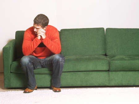 Young man sitting on a sofa