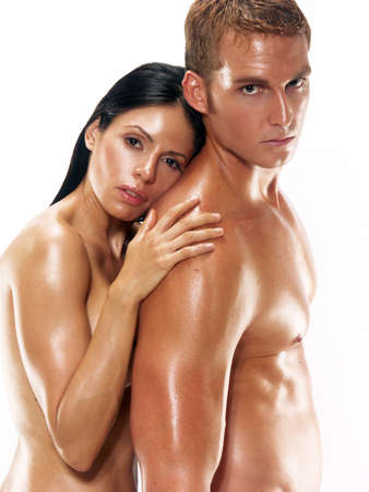 Portrait of young naked couple on white background