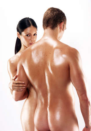 femmes nues sexy: Portrait d'un jeune couple nu sur fond blanc Banque d'images