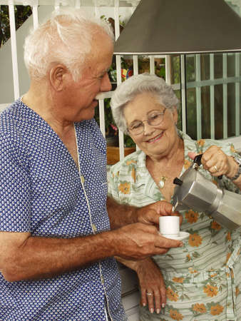 An elderly couple having breakfast in the kitchen Stock Photo - 22542485