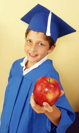 Little kid in graduation gown