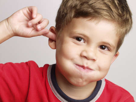blond boy: Little kid with playful expression