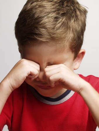 Little kid rubbing eyes Stock Photo