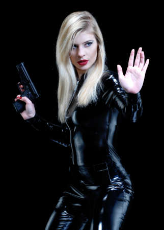 Blonde woman wearing a tight bodysuit on black background