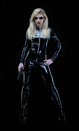 Blonde woman wearing a tight bodysuit on black background photo