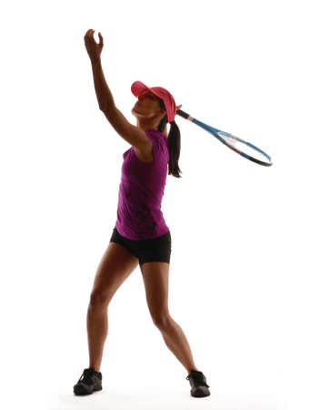 Young woman in gym attire holding a tennis racket on white background photo