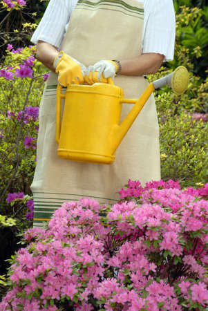 Elderly woman holding a watering can photo