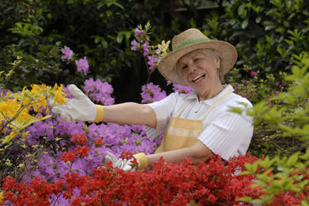 Elderly woman showing off her garden photo