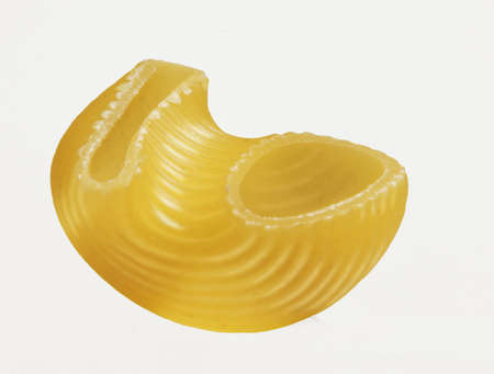 short pasta: A macaroni isolated on white  Stock Photo