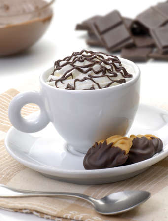 A cup of hot beverage with cookies photo
