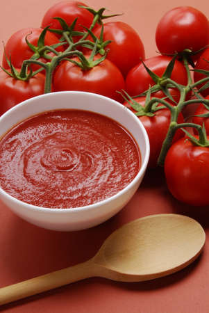 Fresh tomatoes with a bowl of ketchup