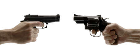 Two guns pointing at each other on white