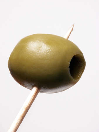 toothpick: Olive on a wooden toothpick on white background  Stock Photo