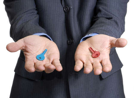 option key: Man in suit offering two different colored keys