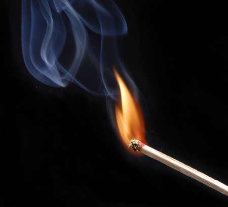 Lit match with smoke on black  Stock Photo
