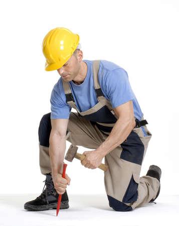 hammering: Construction worker hammering a chisel
