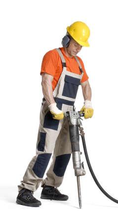ドリルを保持している建設労働者