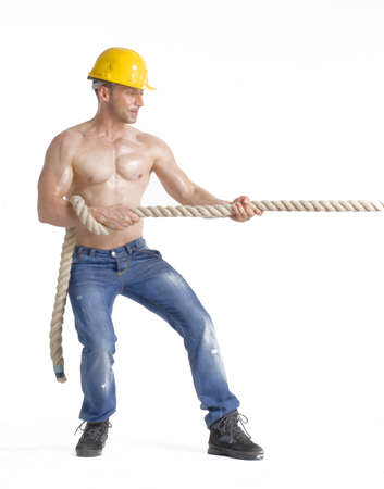 Construction worker pulling a big rope
