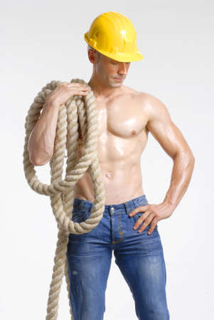 Construction worker holding a big rope photo