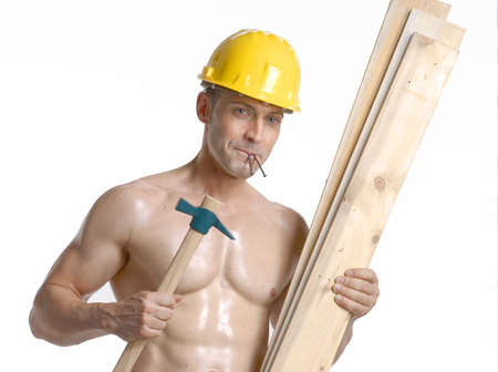 Construction worker holding wooden planks and a hammer photo