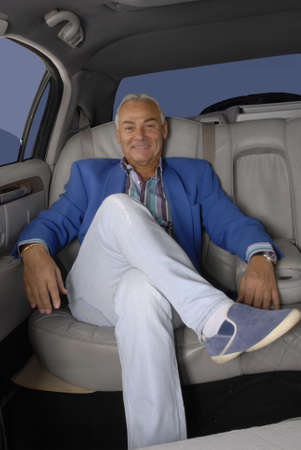 Senior man traveling in car Standard-Bild