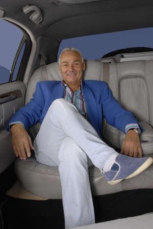 Senior man traveling in car Stock Photo