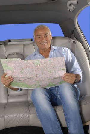 Senior man traveling and looking at map photo