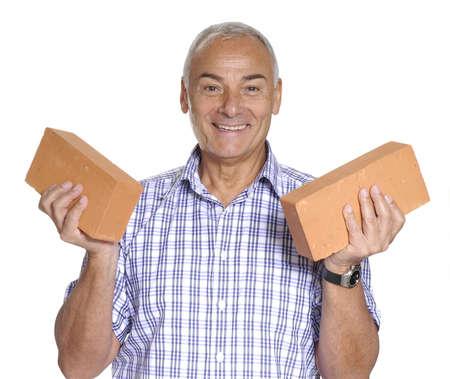 http://us.123rf.com/450wm/gosphotodesign/gosphotodesign1308/gosphotodesign130801868/22767101-senior-man-holding-two-bricks.jpg