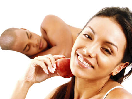 frolicking: Young Hispanic couple with red apple